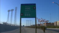 MS, Road sign at port of Long Beach, Terminal Island, Los Angeles County, California, USA