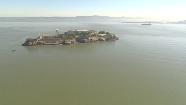 A road winds around the former prison at Alcatraz Island in San Francisco Bay.