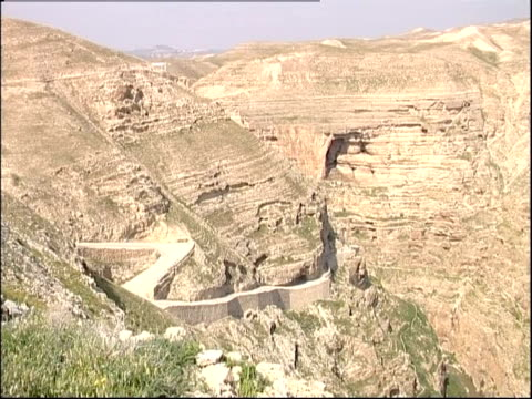 A road wraps around a mountain in the Wadi Qelt.