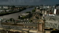 Roads and railways of the Glasgow Central Station span across the River Clyde in Scotland. Available in HD.