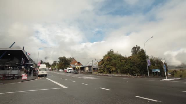 Roads in town of Franz Josef on the West Coast with mist shrouded hills beyond