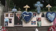 A roadside memorial on Fordham Road in the Bronx / Two Bronx teenagers were killed when their car slammed into an overpass wall on April 11 2011 /...