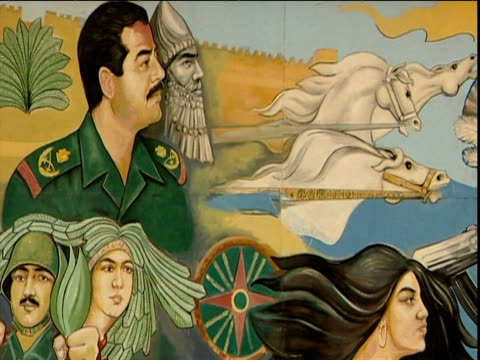 Roadside mural depicting Saddam Hussein next to Sumerian leader Nberkemeza surrounded by Iraqi soldiers and civilians Iraq
