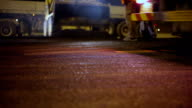 Roadworks laying asphalt