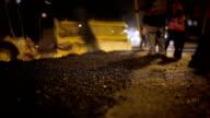 Roadworks. Laying asphalt