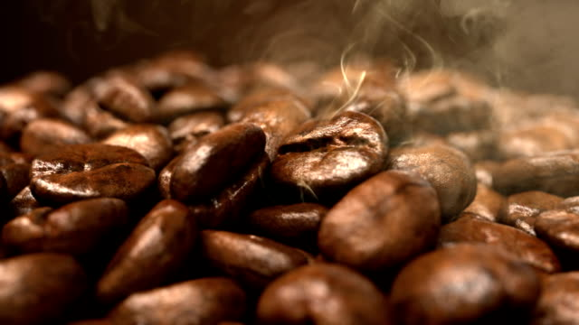 Roasting coffee beans smoke rising