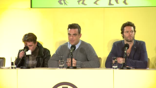 Robbie Williams and Gary Barlow on whether Robbie will do his solo material on tour at the Take That Make A Special Announcement at London England