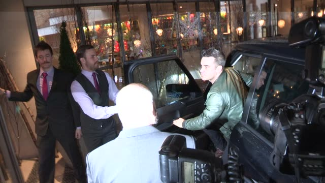 Robbie Williams arriving at The Soho Hotel on November 26 2012 in London England