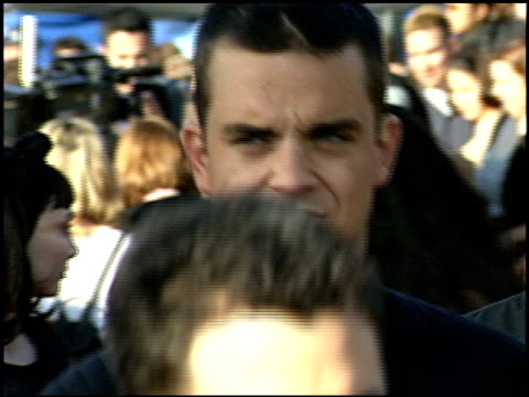 Robbie Williams at the 1999 MTV Movie Awards entrances at Barker Hanger in Santa Monica California on June 5 1999
