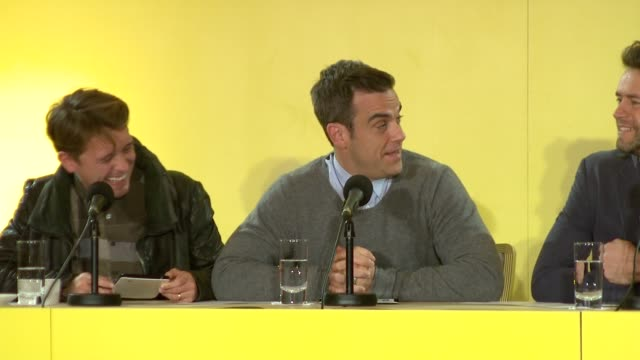 Robbie Williams joking about Samsung and liking technology at the Take That Make A Special Announcement at London England