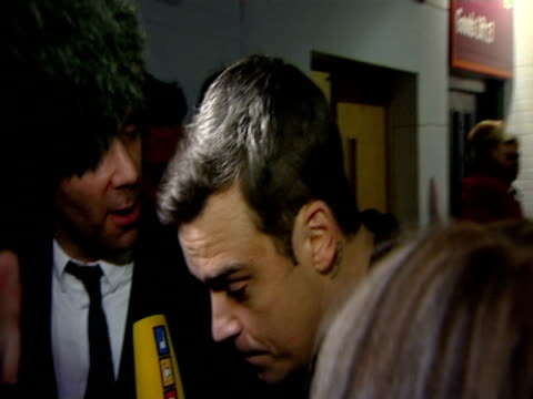 Robbie Williams on rumours that he is trying for a baby at the The Brit Awards 2010 at London England
