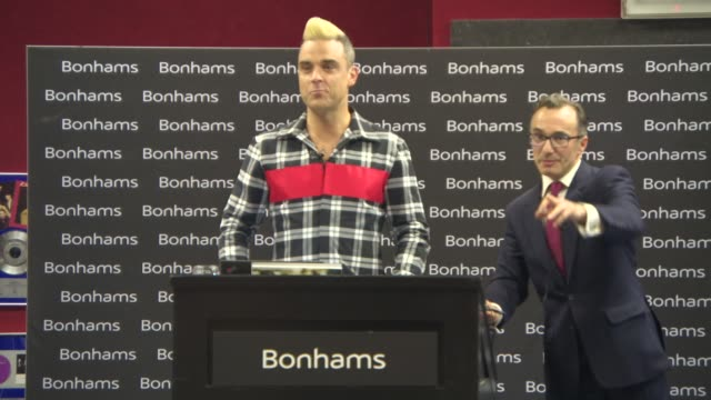 Robbie Williams sells a lot at the Doing It For The Kids Charity Auction at Bonhams on July 15 2015 in London England