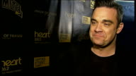 Robbie Williams to turn on Christmas lights in Oxford Street ENGLAND London Oxford Street INT Robbie Williams interview SOT talks of his single