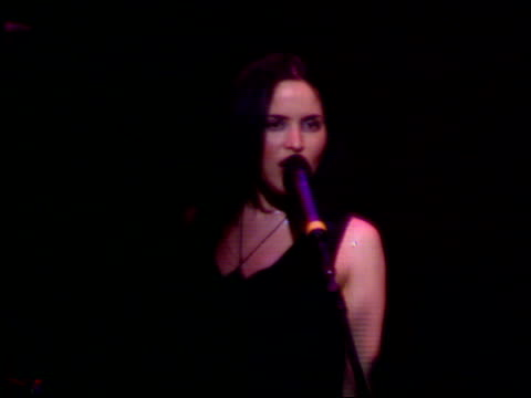 Robbie Williams/Geri Halliwell romance LIB Andrea Corr singing on stage with 'The Corrs'