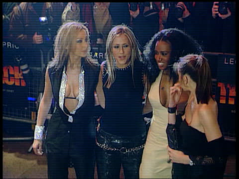 Robbie Williams/Geri Halliwell romance LIBR10020007/ITN Leicester Square All Saints posing for photo opportunity on arrival at premiere of film 'The...