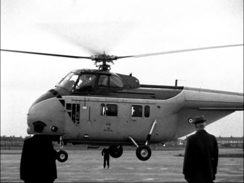 Robert McNamara arrives at London Airport and Ministry of Defence ENGLAND London Airport EXT Robert McNamara down steps from plane McNamara shaking...