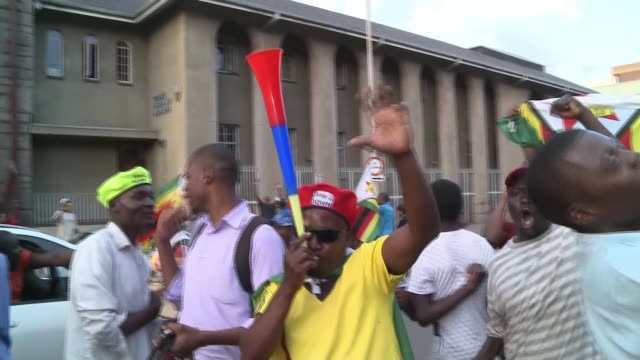 Robert Mugabe resigns as President of Zimbabwe after 37 years ZIMBABWE Harare EXT Various shots people celebrating in street after news of Robert...