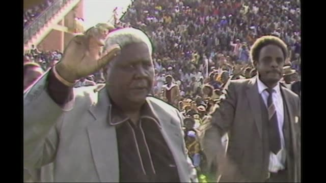 Mugabe profile AS010785004 / TX Joshua Nkomo waving as along