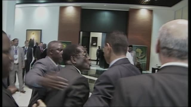Mugabe profile T30060801 / TX EGYPT Sharm elSheikh INT Robert Mugabe speaking as hustled away by bodyguards SOT What has the British to do with...