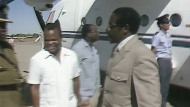 Robert Mugabe under house arrest after military take control AS150484002 / TX Robert Mugabe off plane and greeted and along Mugabe along past...