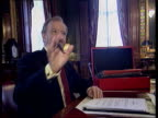Robin Cook revelations LIB Robin Cook MP sat at desk working from red box for photocall