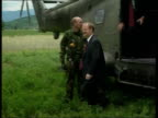 Robin Cook visit/mass graves discovered ITN Helicopter crewman looking out of open door as along over Kosovo MS Robin Cook MP sitting in heli CBV...