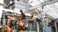 Robotic arms assemble the shell of a GAZelle Next vehicle at the Gaz auto plant operated by Gaz Group in Nizhny Novgorod Russia on Tuesday June 16...