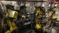 Robotic arms work on the shells of automobiles on the production line at the Volkswagen Group Rus OOO plant in Kaluga Russia on Tuesday Sept 19 2017