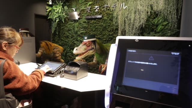 Robotic dinosaurs manufactured by Kokoro Company Ltd stand at the reception desk of the Henn na Hotel Maihama Tokyo Bay operated by HIS Hotel...