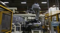 Robotic machinery moves component parts around the production line during the manufacturing of vehicle heaters and air conditioners at the Halla...