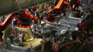 TL Robots assembling car body
