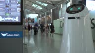 Robots assist travelers clean the floors amongst other tasks at Incheon Airport in South Korea