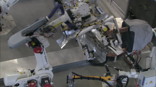 Robots operate in an automotive factory.