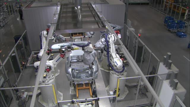 Robots weld automotive parts on an assembly line.