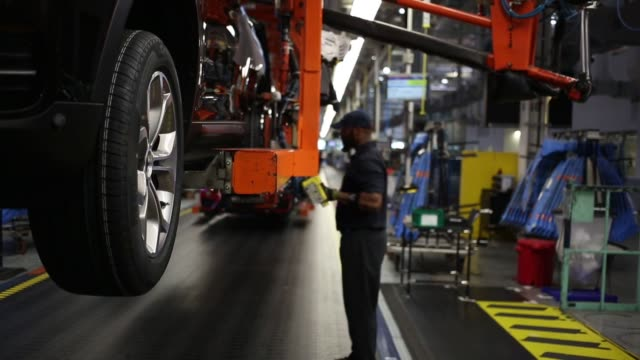 Robots weld metal car bodies and workers assemble pieces of BMW X3 and X5 Vehicles at the BMW Manufacturing Co assembly plant in Greer South Carolina...