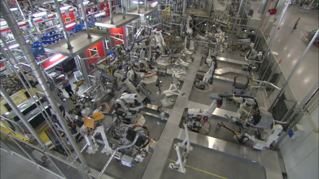 Robots work in an automobile production factory.