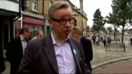 Michael Gove MP campaigning ENGLAND Kent Rochester EXT Michael Gove MP and Conservative party colleagues along street / Michael Gove MP interview SOT...
