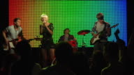 MS SLO MO Rock and roll band performing on stage for enthusiastic crowd / London, UK