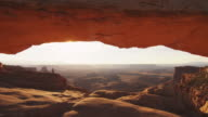 Rock arch in scenic canyon landscape, dolly shot