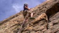 WS LA Rock climber climbing cliff / Provo, Utah, USA