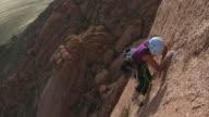 WS Rock climber climbing mountain, Spitzkoppe, Damaraland, Namibia