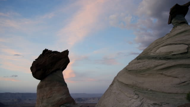 MS T/L TD Rock formation against night to day sky with clouds / Page, Arizona, United States