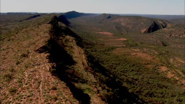 Rock formations form a ridge in the Australian Outback.