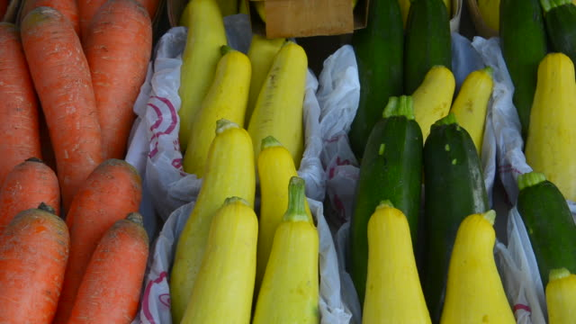 Rockwall Texas downtown Farmers Market selling vegetables summer squash and carrots