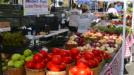 Rockwall Texas downtown Farmers Market selling vegetables to locals with bright fresh fruit and vegetable