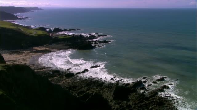 AERIAL, Rocky coastline and Hartland Quay, Devon, England