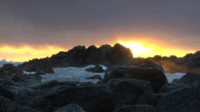 SLO MO CU Rocky coastline at sunset, Ucluelet, British Columbia, Canada