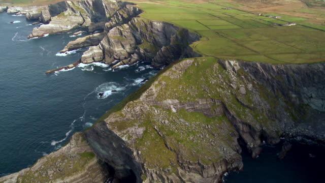 AERIAL WS POV Rocky  coastline near valentia / Kerry, Munster, Ireland