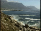 Rocky coastline with Table Mountain in the distance.