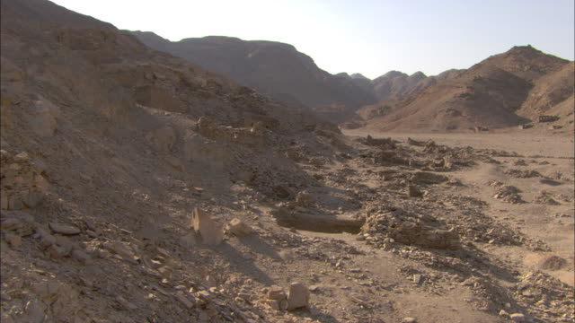 A rocky landscape surrounds a wadi in the ancient emerald mining town of Sikait, Egypt.